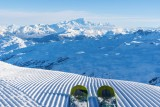 Fresh snow and skiing fun in the 3 Valleys facing Mont Blanc